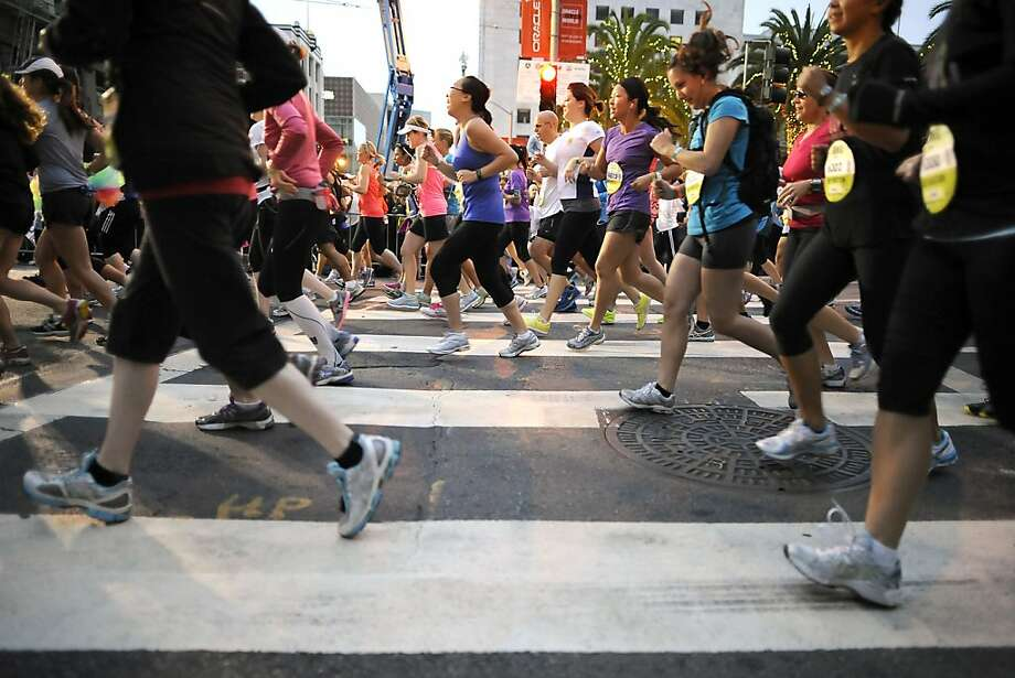 Runners pass Union Square in S.F. at the start of the run that raises money for the Leukemia & Lymphoma Society. Photo: Michael Short, Special To The Chronicle