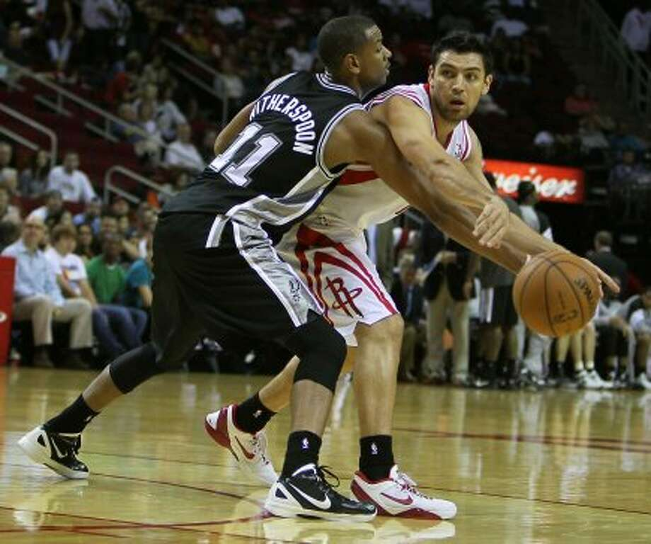 The San Antonio Spurs Wesley Witherspoon left and the Houston Rockets Carlos Delfino during the second quarter of NBA preseason game action at the Toyota Center Sunday, Oct. 14, 2012, in Houston. ( James Nielsen / Chronicle ) (Chronicle)