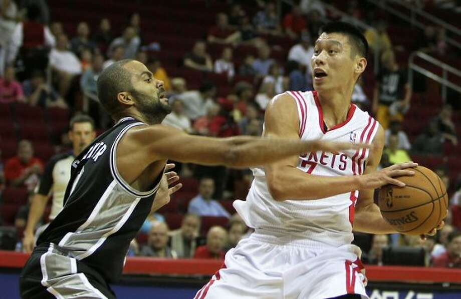 The San Antonio Spurs tony Parker left, and the Houston Rockets Jeremy Lin during the first quarter of NBA preseason game action at the Toyota Center Sunday, Oct. 14, 2012, in Houston. ( James Nielsen / Chronicle ) (Chronicle)