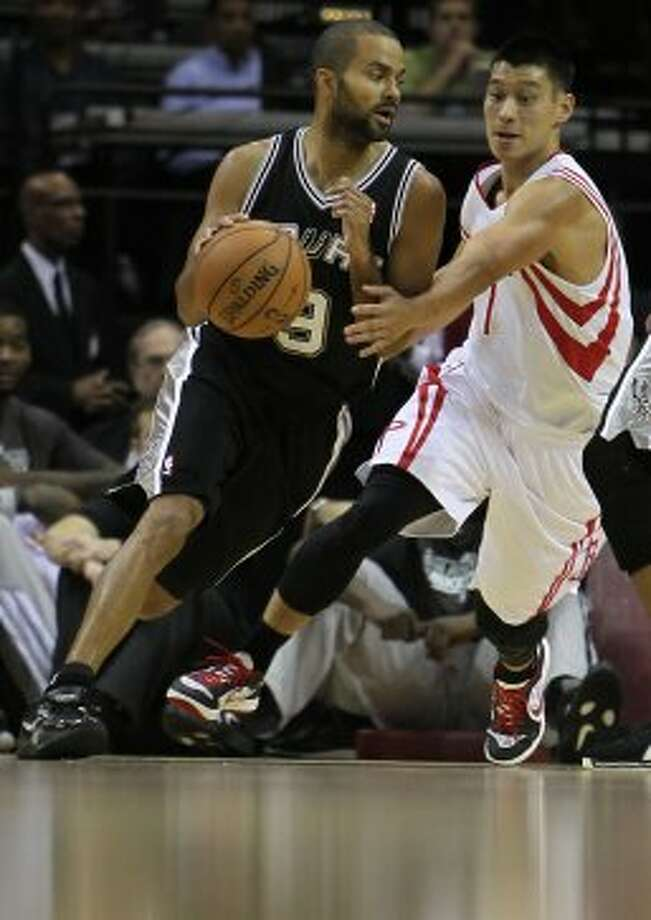 The Houston Rockets Jeremy Lin right, guards the San Antonio Spurs Tony Parker during the first quarter of NBA preseason game action at the Toyota Center Sunday, Oct. 14, 2012, in Houston. ( James Nielsen / Chronicle ) (Chronicle)