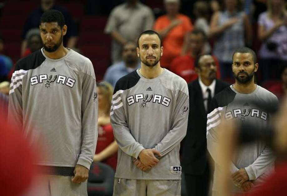 The San Antonio Spurs Tim Diuncan left, Manu Ginobili center, and Tony Parker stand during the national anthem before facing the Houston Rockets in NBA preseason game action at the Toyota Center Sunday, Oct. 14, 2012, in Houston. ( James Nielsen / Chronicle ) (Chronicle)