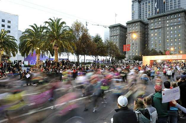 Runners blur past Union Square for the start of the 2012 Nike WomenÕs Marathon & Half Marathon in San Francisco, CA on Sunday, October 14th, 2012 Photo: Michael Short, Special To The Chronicle / SF