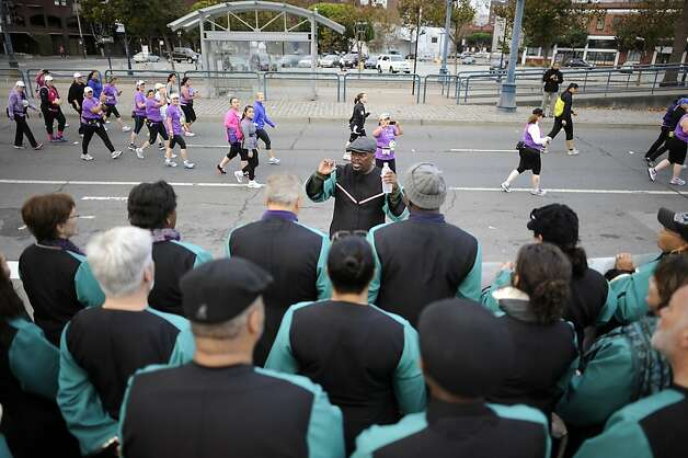 The Oakland Interfaith Gospal Choir sings to participants of the 2012 Nike WomenÕs Marathon & Half Marathon as they run along the Embarcadero in San Francisco, CA on Sunday, October 14th, 2012 Photo: Michael Short, Special To The Chronicle / SF