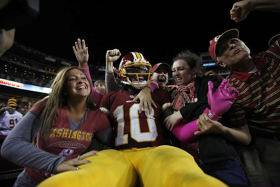 Robert Griffin III savors a moment with the fans after his touchdown run iced Washington's win over Minnesota. He had 13 carries for 138 yards. Photo: Pablo Martinez Monsivais, Associated Press