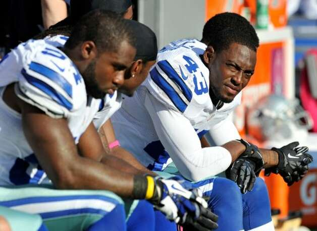 Dallas Cowboys safety Gerald Sensabaugh (43) looks on from the sideline in the second half of an NFL football game against the Baltimore Ravens in Baltimore, Sunday, Oct. 14, 2012. Baltimore won 31-29. (AP Photo/Gail Burton) (Associated Press)