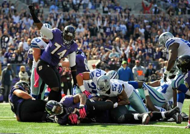 Baltimore Ravens running back Ray Rice, bottom, falls into the end zone for a touchdown in the first half of an NFL football game against the Dallas Cowboys in Baltimore, Sunday, Oct. 14, 2012. (AP Photo/Gail Burton) (Associated Press)