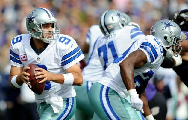 Dallas Cowboys quarterback Tony Romo (9) looks for a receiver in the first half of an NFL football game against the Baltimore Ravens in Baltimore, Sunday, Oct. 14, 2012. (AP Photo/Nick Wass) (Associated Press)