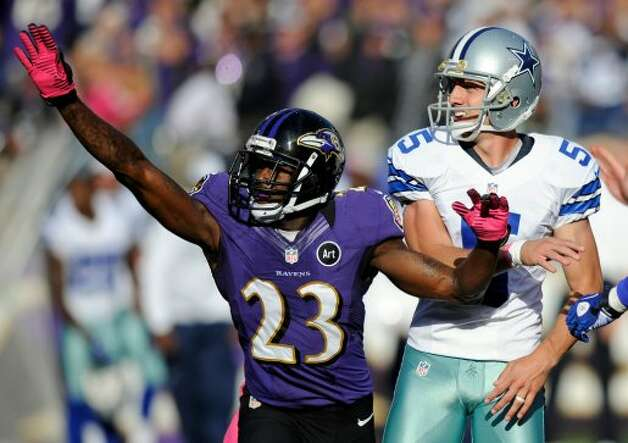 Baltimore Ravens defensive back Chykie Brown (23) reacts in front of Dallas Cowboys kicker Dan Bailey after Bailey missed a field goal attempt in the second half of an NFL football game in Baltimore, Sunday, Oct. 14, 2012. Baltimore won 31-29. (AP Photo/Nick Wass) (Associated Press)