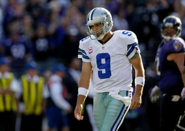 Dallas Cowboys quarterback Tony Romo walks off the field after a failed two-point conversion attempt in the second half of an NFL football game against the Baltimore Ravens in Baltimore, Sunday, Oct. 14, 2012. Baltimore won 31-29. (AP Photo/Patrick Semansky) (Associated Press)