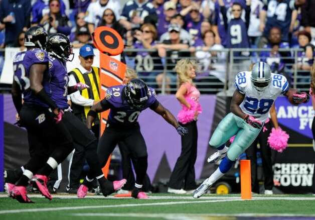 Dallas Cowboys running back Felix Jones, right, falls into the end zone for a touchdown in front of Baltimore Ravens defenders Jameel McClain, from left, Bernard Pollard and Ed Reed in the first half of an NFL football game in Baltimore, Sunday, Oct. 14, 2012. (AP Photo/Nick Wass) (Associated Press)