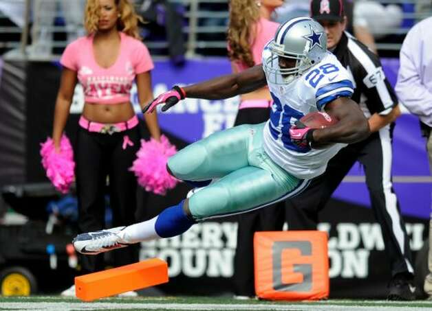 Dallas Cowboys running back Felix Jones falls into the end zone for a touchdown in the first half of an NFL football game against the Baltimore Ravens in Baltimore, Sunday, Oct. 14, 2012. (AP Photo/Nick Wass) (Associated Press)