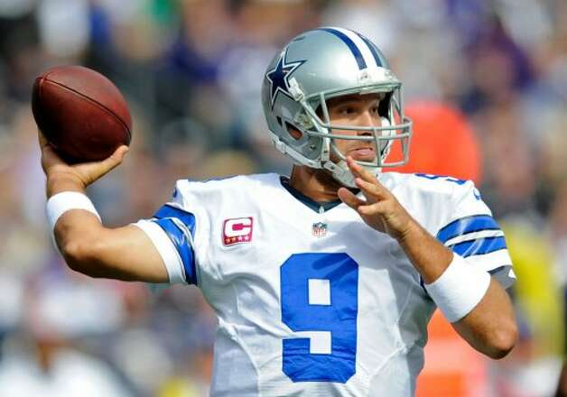 Dallas Cowboys quarterback Tony Romo throws to a receiver in the first half of an NFL football game against the Baltimore Ravens in Baltimore, Sunday, Oct. 14, 2012. (AP Photo/Nick Wass) (Associated Press)