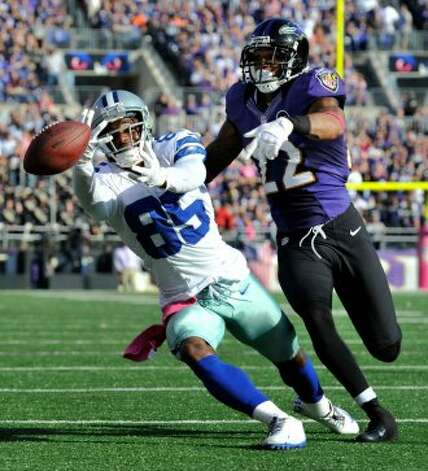 Dallas Cowboys wide receiver Kevin Ogletree, left, misses a pass as he is defended by Baltimore Ravens defensive back Jimmy Smith in the second half of an NFL football game in Baltimore, Sunday, Oct. 14, 2012. Baltimore won 31-29. (AP Photo/Gail Burton) (Associated Press)