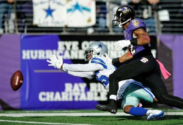 Dallas Cowboys wide receiver Kevin Ogletree, center, misses a pass as he is defended by Baltimore Ravens defensive back Jimmy Smith in the second half of an NFL football game in Baltimore, Sunday, Oct. 14, 2012. Baltimore won 31-29. (AP Photo/Nick Wass) (Associated Press)