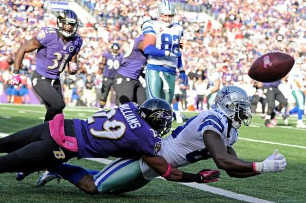 Cowboys receiver Dez Bryant (88) is hit by Ravens cornerback Cary Williams as Bryant misses a two-point conversion that would have tied the game in the fourth quarter at M&T Bank Stadium on October 14, 2012 in Baltimore, Maryland. The Baltimore Ravens won, 31-29. (Patrick Smith/Getty Images) (Getty Images)