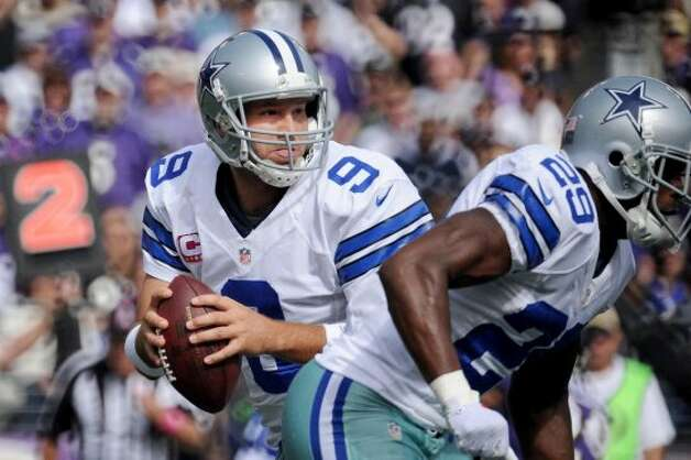 Quarterback Tony Romo #9 of the Dallas Cowboys drops back into the pocket before throwing against the Baltimore Ravens in the first quarter at M&T Bank Stadium on October 14, 2012 in Baltimore, Maryland. The Baltimore Ravens won, 31-29. (Photo by Patrick Smith/Getty Images) (Getty Images)