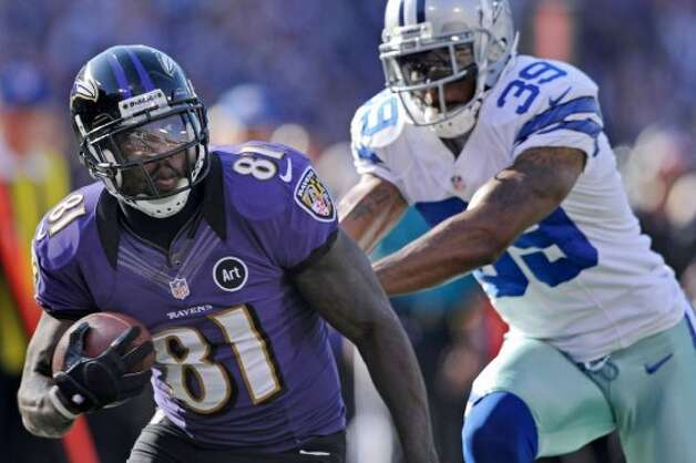 Wide receiver Anquan Boldin #81 of the Baltimore Ravens pulls in a catch as cornerback Brandon Carr #39 of the Dallas Cowboys pushes him from behind in the third quarter against the Dallas Cowboys at M&T Bank Stadium on October 14, 2012 in Baltimore, Maryland. The Baltimore Ravens won, 31-29. (Photo by Patrick Smith/Getty Images) (Getty Images)