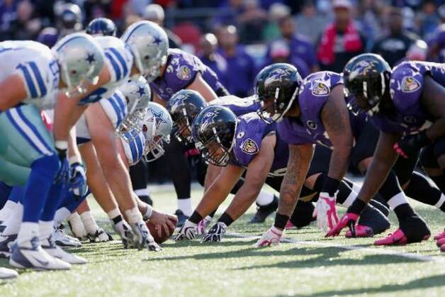 The Dallas Cowboys offense lines up against the Baltimore Ravens defense during the second half at M&T Bank Stadium on October 14, 2012 in Baltimore, Maryland.  (Photo by Rob Carr/Getty Images) (Getty Images)