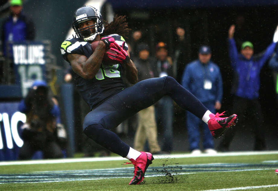 Seattle Seahawks player Sidney Rice pulls in a final touchdown against the New England Patriots in the fourth quarter of an NFL game on Sunday, October 14, 2012 at CenturyLink Field in Seattle. Photo: JOSHUA TRUJILLO / SEATTLEPI.COM