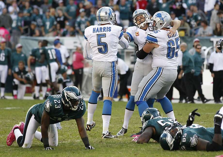 Detroit's Jason Hanson (middle) is congratulated after his 45-yard field goal in overtime lifted the Lions to their 2nd win. Photo: Mel Evans, Associated Press