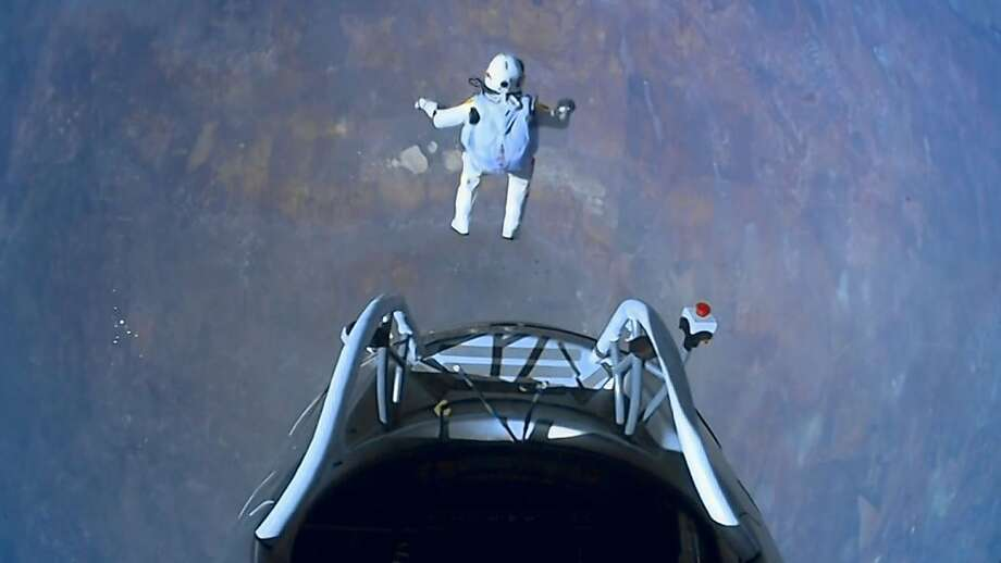 This image made from video, provided by Red Bull Stratos shows pilot Felix Baumgartner of Austria as he jumps out of the capsule during the final manned flight for Red Bull Stratos on Sunday, Oct. 14, 2012. In a giant leap from more than 24 miles up, Baumgartner shattered the sound barrier Sunday while making the highest jump ever ? a tumbling, death-defying plunge from a balloon to a safe landing in the New Mexico desert. (AP Photo/Red Bull Stratos) Photo: Associated Press