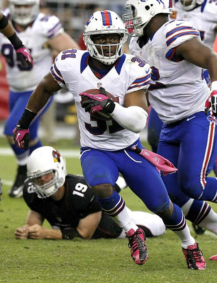 Buffalo's Jarius Byrd runs back an interception to set up the decisive field goal. Photo: Rick Scuteri, Associated Press