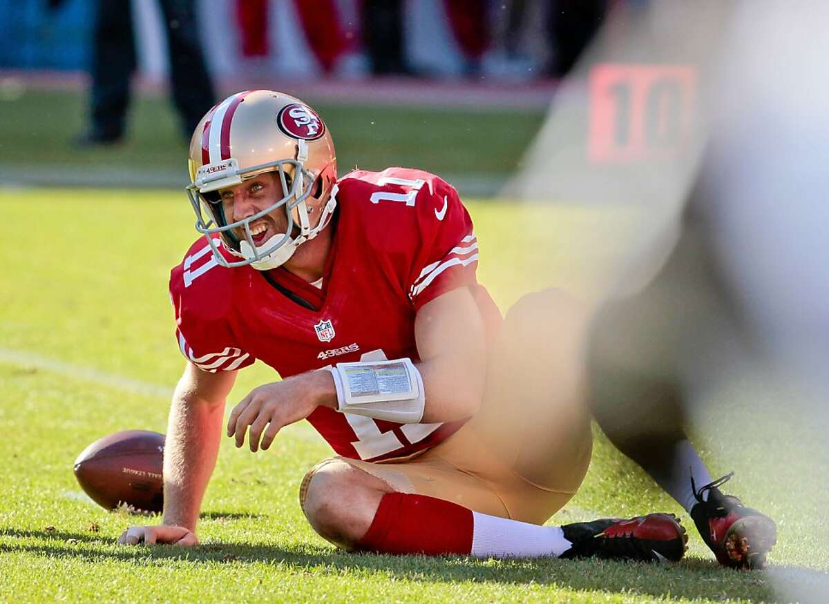 49ers quarterback Alex Smith gets up off the turf after being sacked by Linebacker Mathias Kiwanuka in the 2nd half as the San Francisco 49ers lose to the New York Giants at Candlestick Park in San Francisco , Calif., on Sunday, Oct.14th, 2012