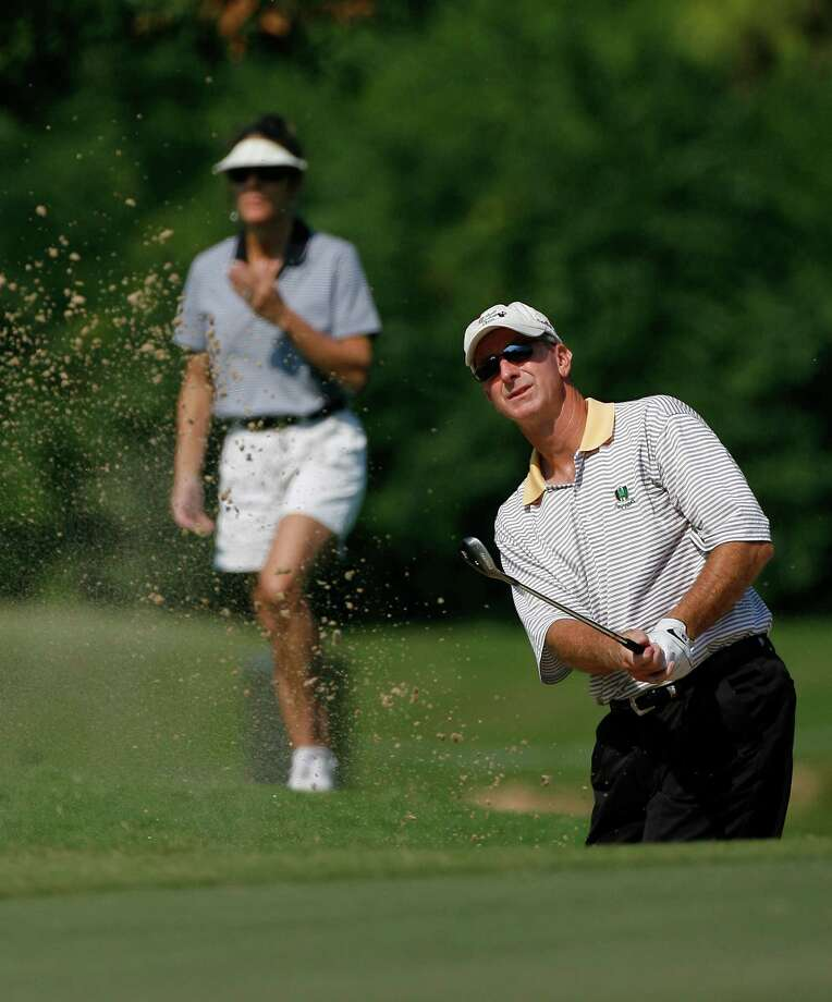 Gary Durbin hits out of a sand trap at the Men's Houston Amateur Golf Tournament being held at Memorial Park Golf Course this weekend.  (Friday, Sept. 21, 2007, in Houston. ( Steve Campbell / Chronicle) Photo: Steve Campbell / Houston Chronicle