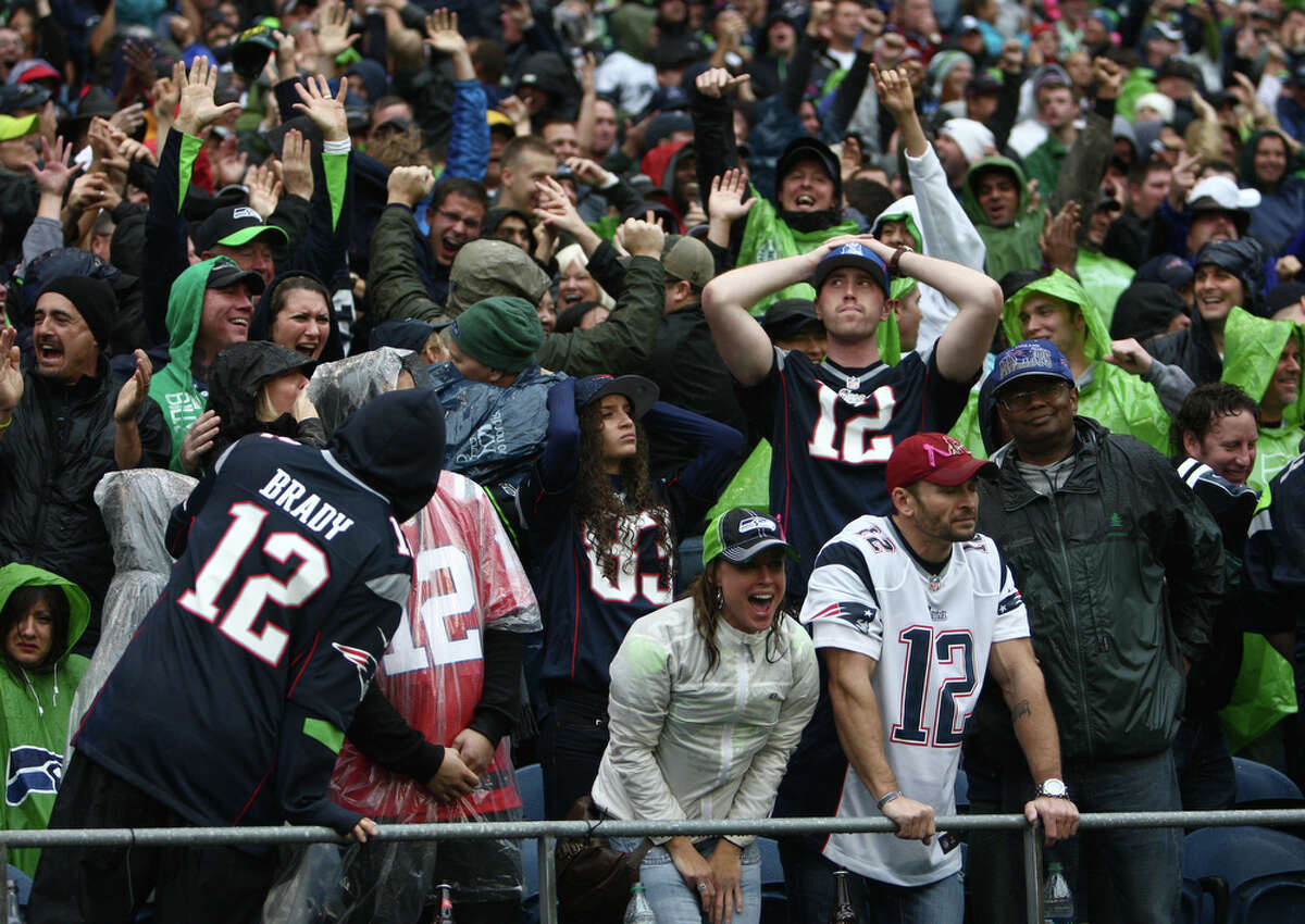 Seattle Seahawks fans erupt in celebration after the Hawks scored a winning touchdown in the fourth quarter against the New England Patriots on Sunday, October 14, 2012 at CenturyLink Field in Seattle. The Hawks beat the Patriots 24 to 23.