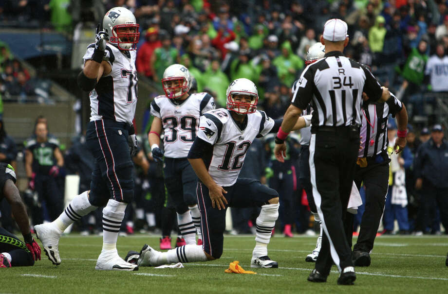 New England Patriots quarterback Tom Brady, center, argues with an official after the Patriots were called for a penalty against the Seahawks on Sunday, October 14, 2012 at CenturyLink Field in Seattle. The Hawks beat the Patriots 24 to 23. Photo: JOSHUA TRUJILLO / SEATTLEPI.COM