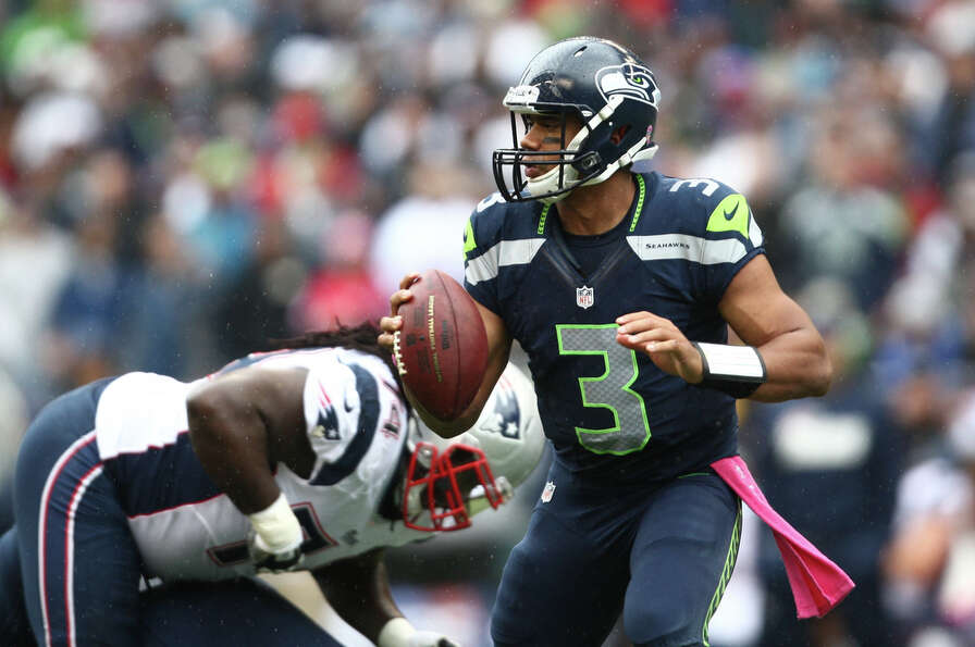 Seattle Seahawks quarterback Russell Wilson readies to throw the ball against the New England Patrio