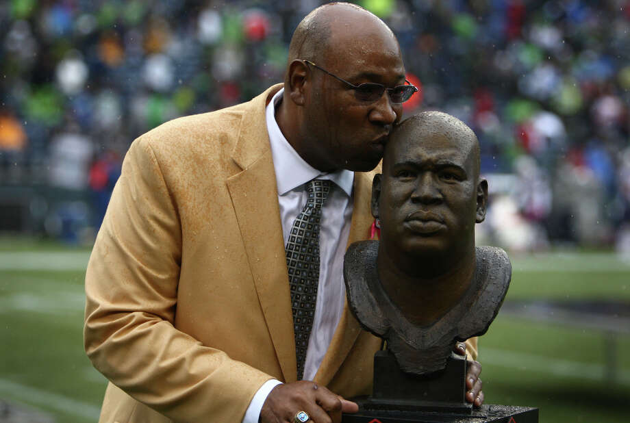 Seattle Seahawks Hall of Fame player Cortez Kennedy kisses his bust as his jersey, number 96, is retired during halftime of a game against the New England Patriots on Sunday, October 14, 2012 at CenturyLink Field in Seattle. The Hawks beat the Patriots 24 to 23. Photo: JOSHUA TRUJILLO / SEATTLEPI.COM