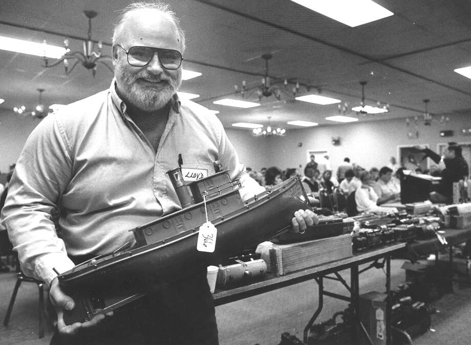 Stamford native Lloyd Ralston shows off an antique tugboat that sold for $10,000 early in the Oct. 17, 1987, toy auction he organized. The two-day auction, which drew buyers from as far away as Germany, continues in the background. It was expected to gross $250,000, with one-quarter of reciepts, or about $62,500 for Ralston. Photo: The (Stamford) Advocate