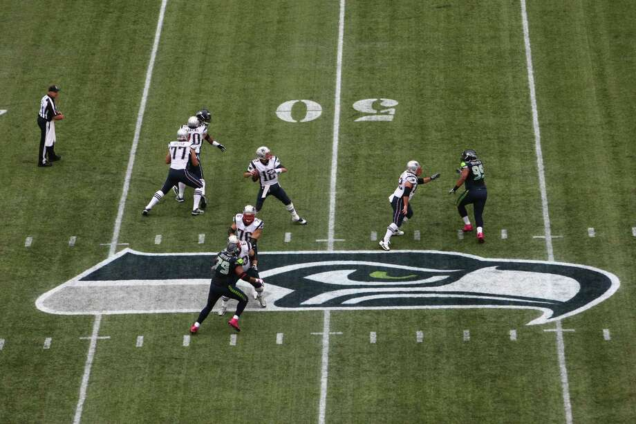New England Patriots quarterback Tom Brady throws in the first half against the Seattle Seahawks on Sunday, October 14, 2012 at CenturyLink Field in Seattle. The Hawks beat the Patriots 24 to 23. Photo: JOSHUA TRUJILLO / SEATTLEPI.COM