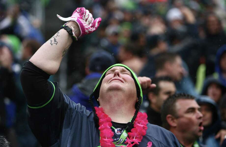"Seattle Seahawks fan Lorin ""Big Lo"" Sandretzky gestures skyward after a field goal put the Seattle Seahawks over the New England Patriots late in the fourth quarter on Sunday, October 14, 2012 at CenturyLink Field in Seattle. The Hawks beat the Patriots 24 to 23. Photo: JOSHUA TRUJILLO / SEATTLEPI.COM"