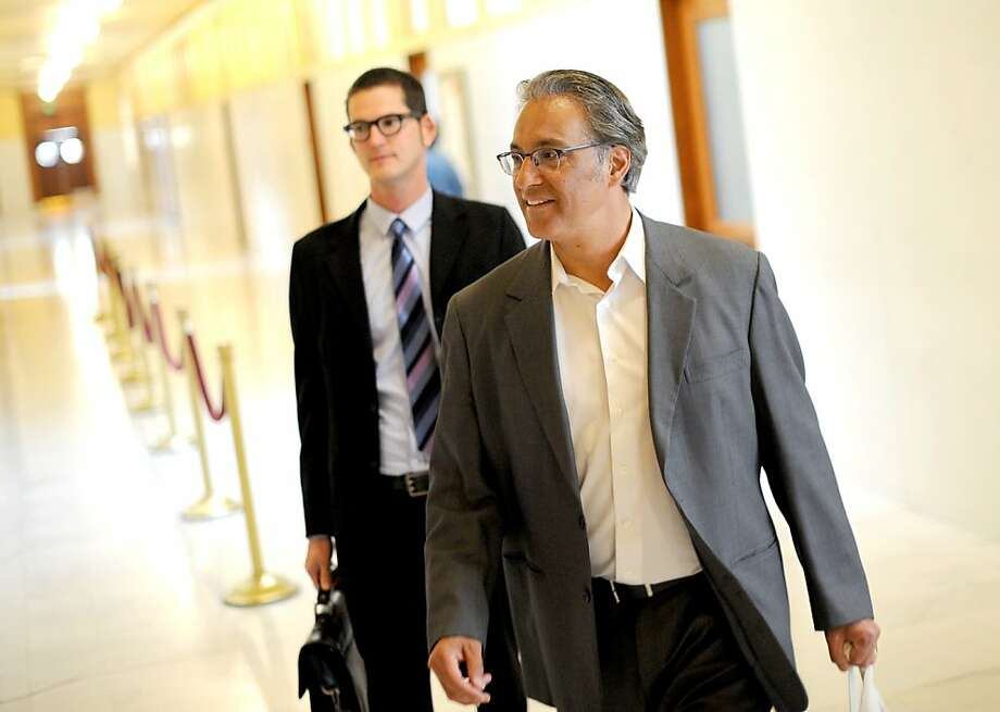 Ross Mirkarimi (right), with his attorney David Waggoner, has been reinstated as sheriff but is on three years' probation after pleading guilty to a misdemeanor count of false imprisonment stemming from an argument with his wife. Photo: Noah Berger, Special To The Chronicle