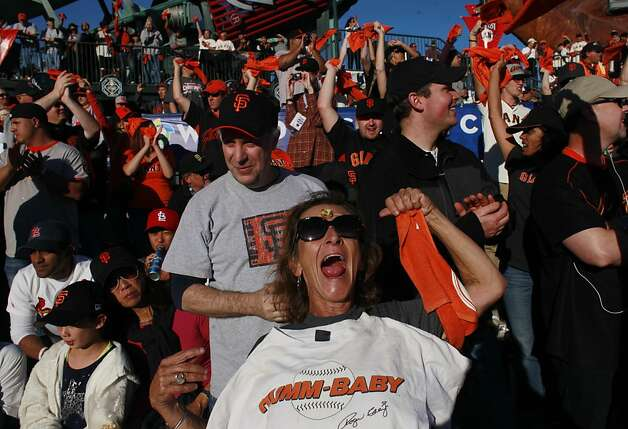 Bonnie Covalt, of Rocklin, cheers at the Giants starting lineup takes the field at the start of the NLCS Game 1against the St. Louis Cardinals on Sunday Oct. 14, 2012 in San Francisco, Calif. Photo: Mike Kepka, The Chronicle