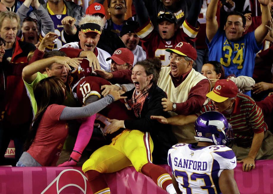 Redskins quarterback Robert Griffin III (10) celebrates with fans after a 76-yard touchdown run in the second half of Washington's 38-26 win at Landover, Md. Griffin's scoring run was the longest by an NFL quarterback since Kordell Stewart's 80-yarder for Pittsburgh against Carolina in 1996. Photo: Pablo Martinez Monsivais / AP