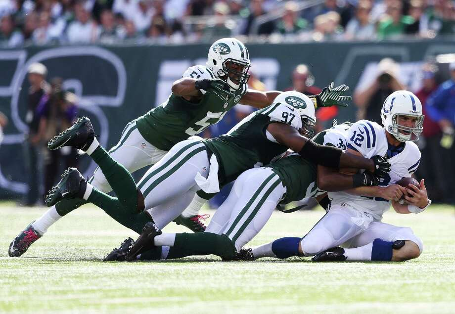 EAST RUTHERFORD, NJ - OCTOBER 14:  Andrew Luck #12 of the Indianapolis Colts is sacked by Aaron Maybin #51, Calvin Pace #97 and Antonio Allan #39 of the New York Jets at MetLife Stadium on October 14, 2012 in East Rutherford, New Jersey.  (Photo by Nick Laham/Getty Images) Photo: Nick Laham