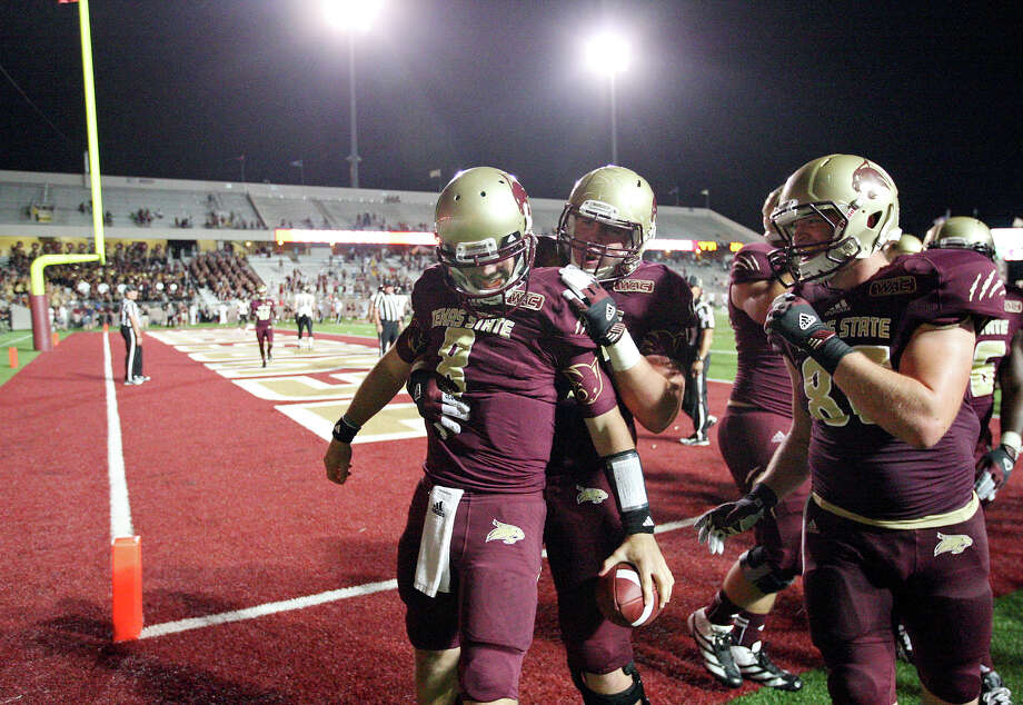 Texas State Bobcats' Duke DeLancellotti (from left) is congratulated by teammates Texas State Bobcats' Tyler Potter and Texas State Bobcats' Ed Amerson after scoring a touchdown against the Idaho Vandals during second half action Saturday Oct. 13, 2012 at Bobcat Stadium in San Marcos, Tx. Texas State won 38-7. Photo: Edward A. Ornelas, Express-News / © 2012 San Antonio Express-News