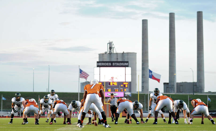 The old Longhorn Quarry serves a backdrop during a 26-5A Football game between the Reagan Rattlers and the Madison Mavericks at Heroes Stadium in San Antonio, Saturday, October 13, 2012.