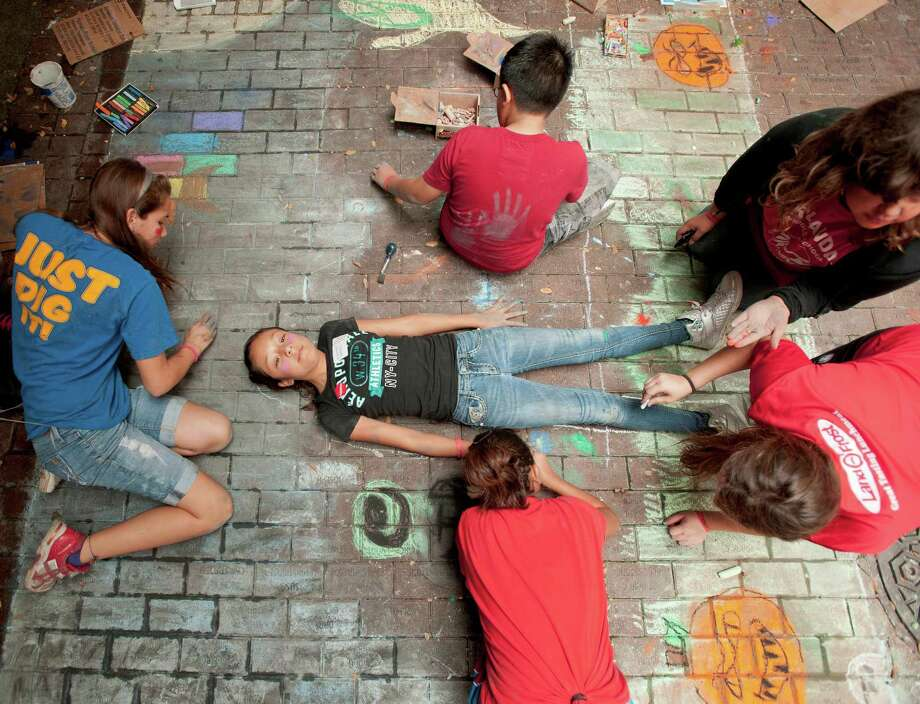 Students from Harlandale Middle School work on a mural during Artpace's Chalk It Up, Saturday, Oct. 13, 2012, in Downtown San Antonio. Photo: Darren Abate, Express-News
