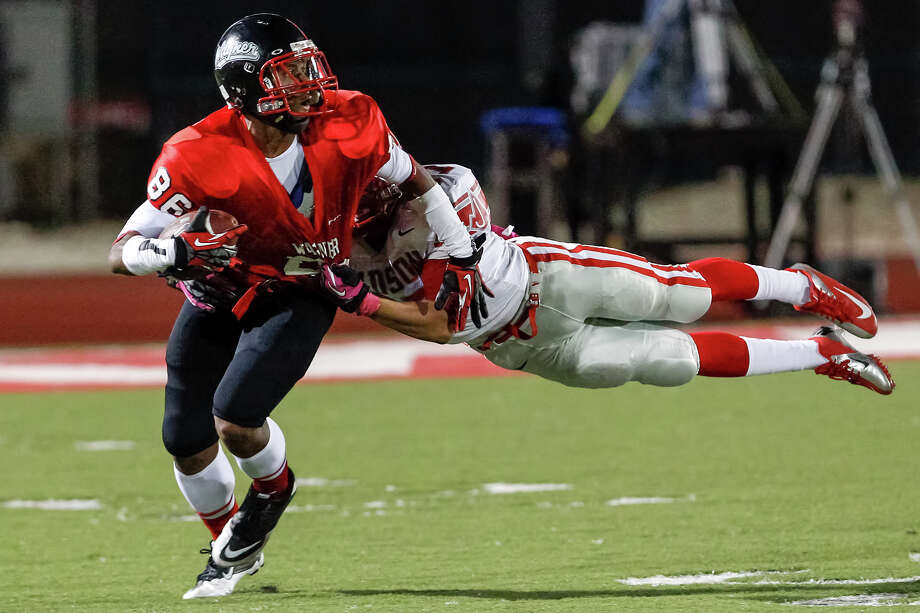 "Judson's Shawn Calvin makes a diving tackle on Wagner's Xavier La Grant during the third quarter of their game at Rutledge Stadium on Oct. 12, 2012. Judson won the ""Hammer Bowl"" 30-0.  MARVIN PFEIFFER/ mpfeiffer@express-news.net Photo: MARVIN PFEIFFER, Express-News / Express-News 2012"