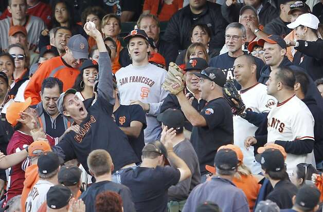 A fan reacts as he catches a foul ball in the second inning during game 1 of the NLCS at AT&T Park on Sunday, Oct. 14, 2012 in San Francisco, Calif. Photo: Brant Ward, The Chronicle