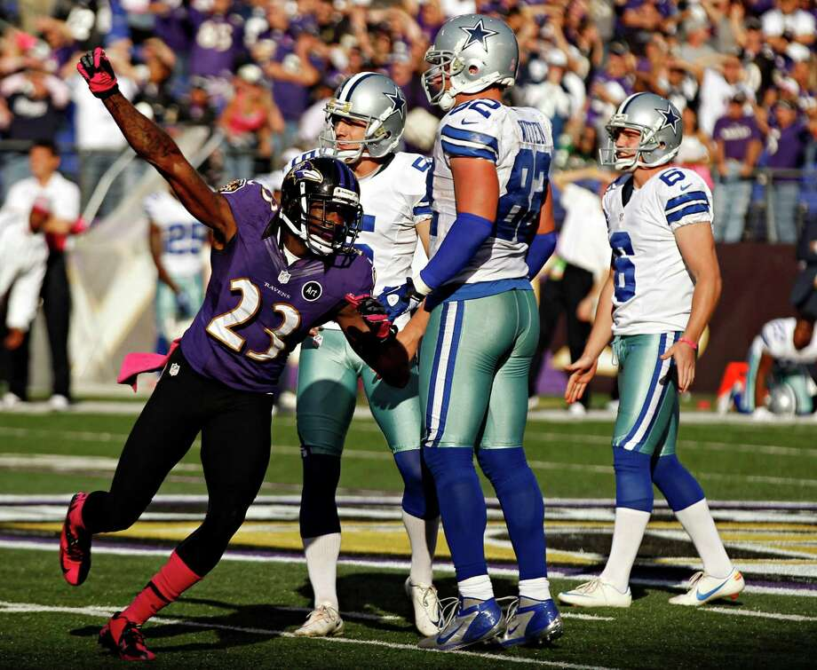 The Cowboys, including kicker Dan Bailey (5), watch helplessly as the Ravens' Chykie Brown celebrates Bailey's miss with two seconds remaining. Photo: G.J. McCarthy / Dallas Morning News