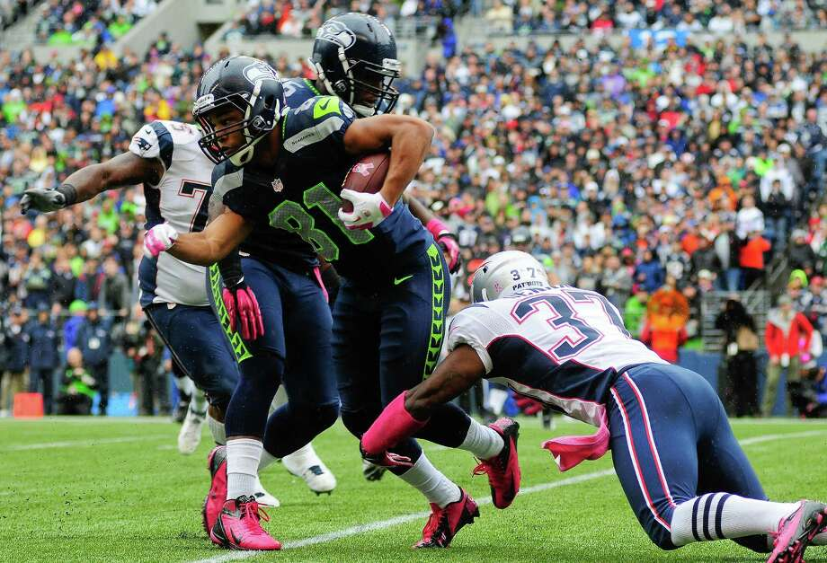 Alfonzo Dennard (37) tackles Seahawk Golden Tate on a pass from Russell Wilson during the first quarter at the Seahawks game against the Patriots at CenturyLink Field on Sunday, October 14, 2012. The Seahawks took the game 24-23. Photo: LINDSEY WASSON / SEATTLEPI.COM