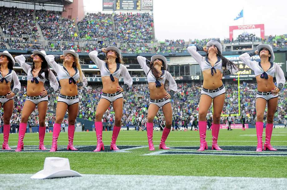 The Sea Gals perform in the rain during the Seahawks game against the Patriots at CenturyLink Field on Sunday, October 14, 2012. The Seahawks took the game 24-23. Photo: LINDSEY WASSON / SEATTLEPI.COM