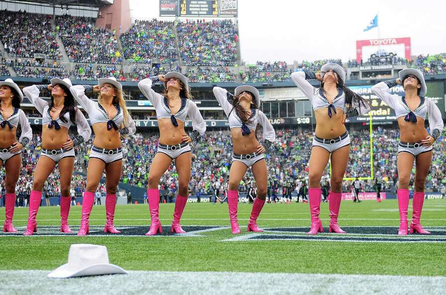 The Sea Gals perform in the rain during the Seahawks game against the Patriots at CenturyLink Field