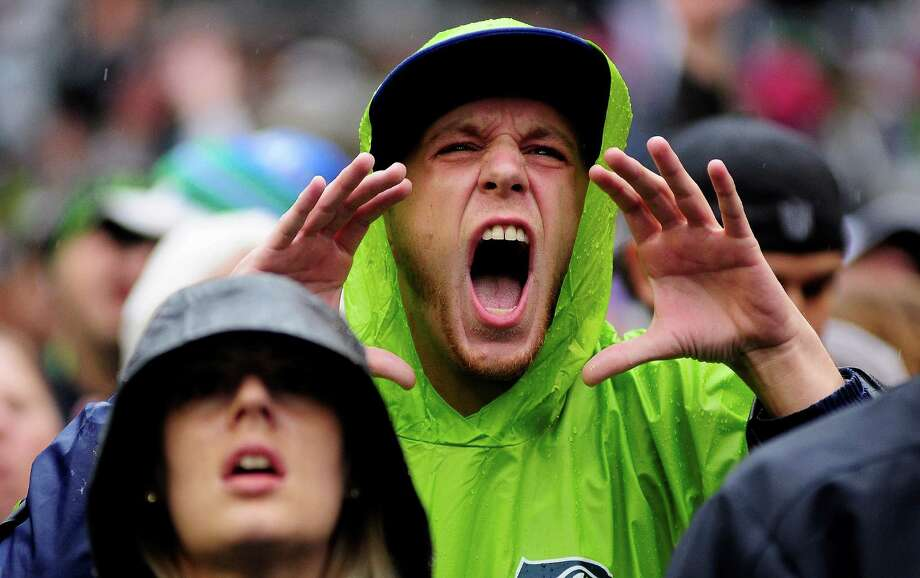 A fan puts his hands to his face as he cheers loudly during the Seahawks game against the Patriots at CenturyLink Field on Sunday, October 14, 2012. The Seahawks took the game 24-23. Photo: LINDSEY WASSON / SEATTLEPI.COM