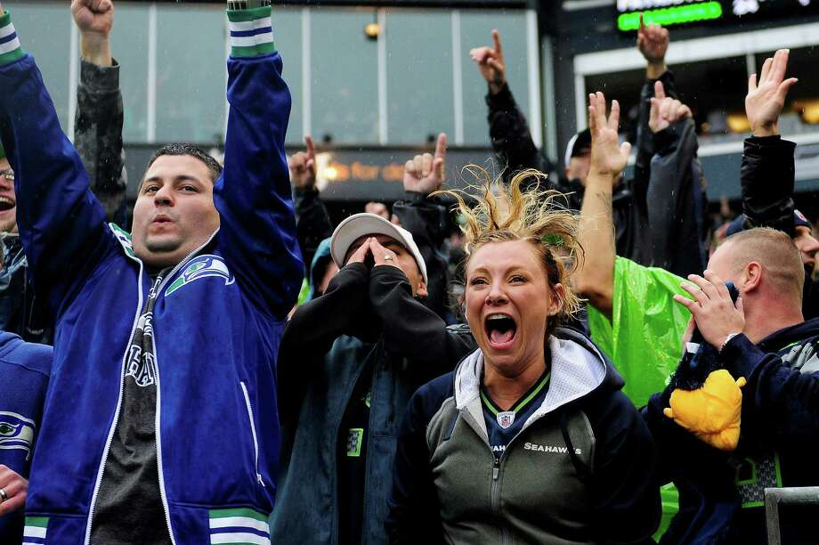 Fans scream as the Seahawks manage to narrowly beat the Patriots at CenturyLink Field on Sunday, October 14, 2012. The Seahawks took the game 24-23. Photo: LINDSEY WASSON / SEATTLEPI.COM